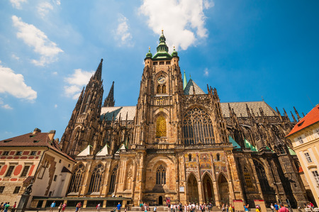 PRAGUE, CZECH REPUBLIC - JUNE 21, 2016: Saint Vitus Cathedral  and tourists at square under blue sky
