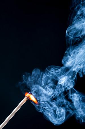 Ignition match with smoke on black background Stock Photo