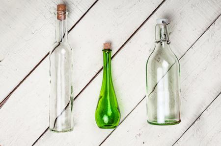 white wine: Empty vintage bottles with corks  on grunge wooden background Stock Photo