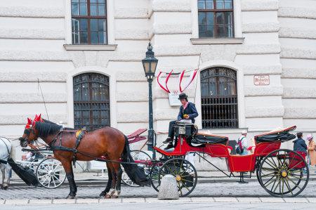 VIENNA, AUSTRIA - JUNE 04, 2017: Traditional old-fashioned fiacres at Michaelerplatz near Hofburg