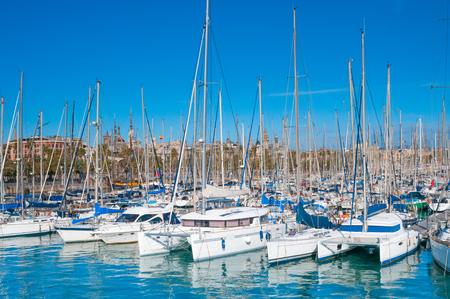 Sailboats and sailing ships at sea pier