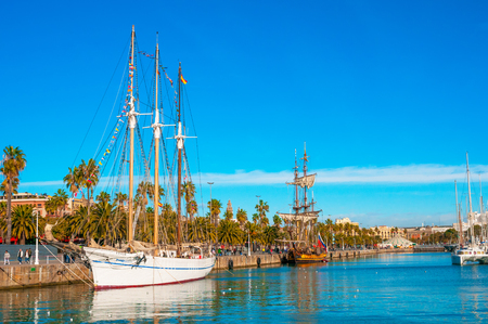 BARCELONA, SPAIN - JANUARY 02, 2018: Sailboats and sailing ships in bright sunny day at Port Vell