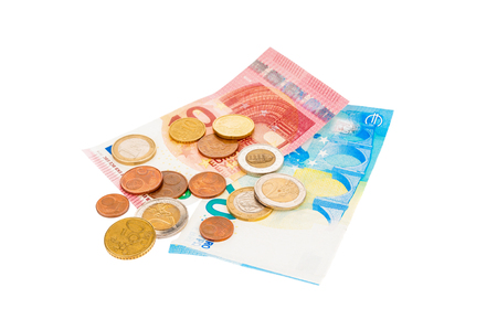 Cash banknotes and coins euro on white background