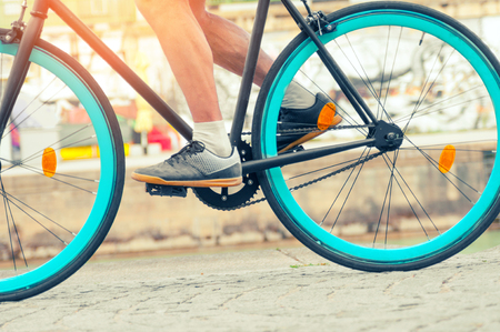 Biker riding on his fixed bike on cobblestone