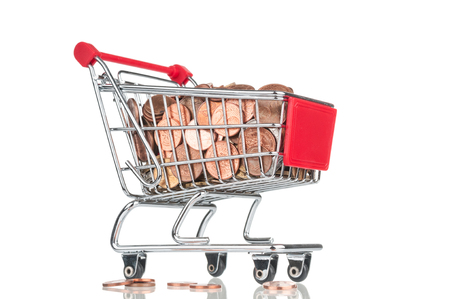 Shopping cart full of coins on white background. Bottom view