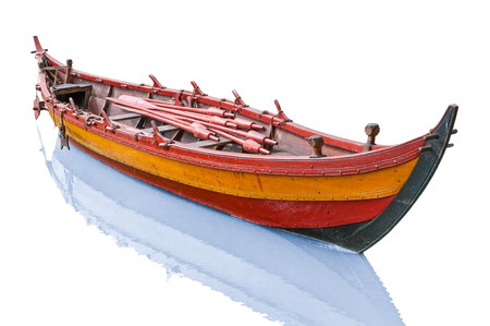 Old antique wooden boat isolated on white background