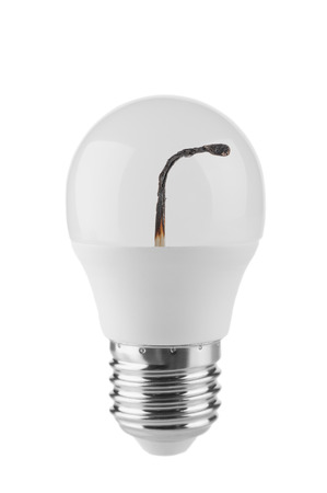 LED bulb and burnt match inside on white background