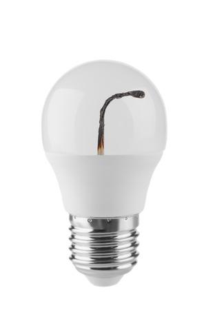 LED bulb and burnt match inside on white background