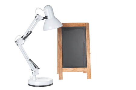Table lamp and chalkboard on white background Stock Photo