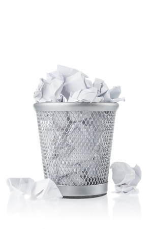 Waste paper in rubbish bin on white background Stockfoto