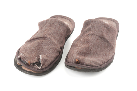 Pair of ragged home slippers close up isolated on white background Reklamní fotografie