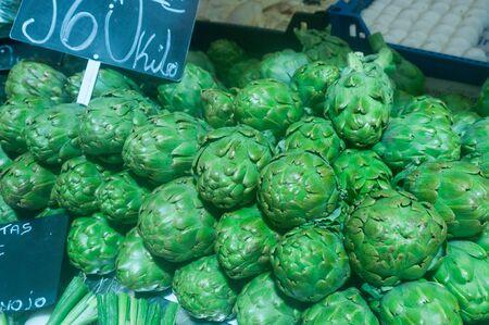 Ripe artichokes on market stall
