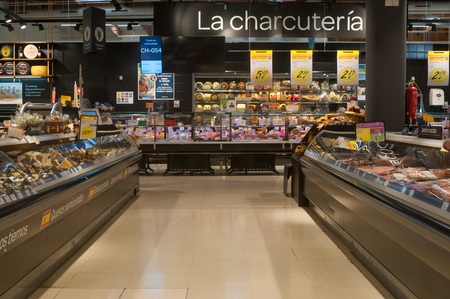 VALENCIA, SPAIN- JUNE 21, 2019: Interior of meat section in the supermarket Carrefour in Valencia, Spain