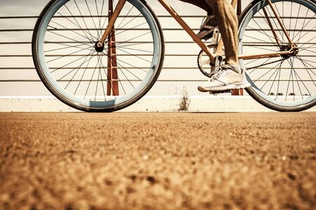 Biker riding on his fixed bike on pebble track Imagens