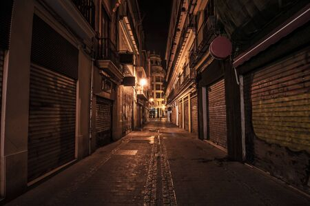 Narrow street at night in the old town