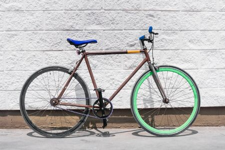 Old fixed gear bicycle on white wall background