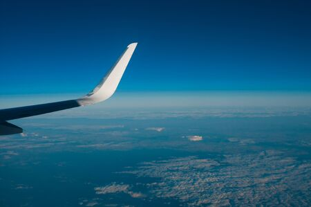Aerial view from plane on blue sky Stock Photo