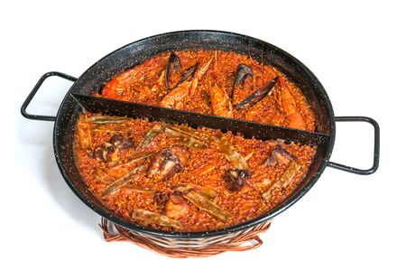 Paella in pan isolated on white background Stock Photo