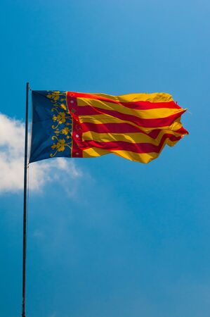 Flag of Community Valencia blowing on the wind