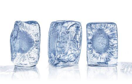 Three blue ice cubes close up isolated on white background Stockfoto