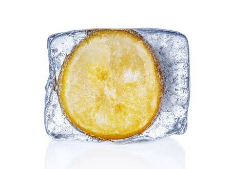 Lemon frozen in ice cube on white background