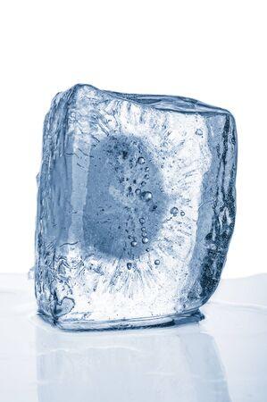Blue ice block close up on white background