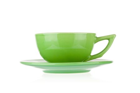 Green teacup with saucer isolated on white background Zdjęcie Seryjne