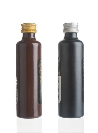 Two small alcohol bottles on white background