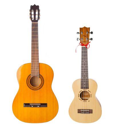 Acoustic and ukulele guitars isolated on white background Banco de Imagens