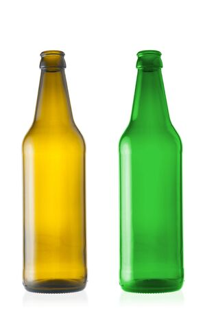 Two empty beer bottles close up isolated on white background