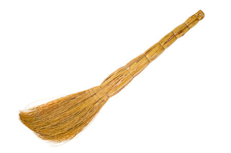Straw besom close up isolated on white background