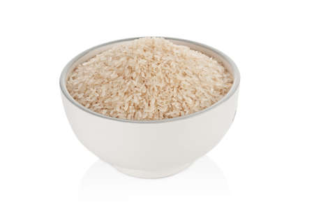 Dry rice in ceramic bowl isolated on white background