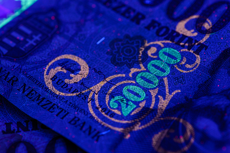 HUF 20,000 Hungarian banknote in UV light. Fluorescent motives are clearly visible. Europe Hungary.