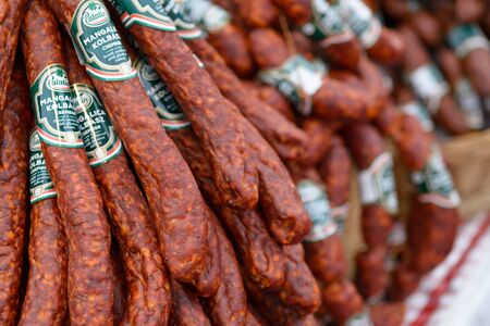 BEKESCSABA, HUNGARY - OKT 19, 2018: Sausage Festival (Csabai Kolbaszfesztival) Sausage exhibition and fair. Smoked thin sausages, close-up