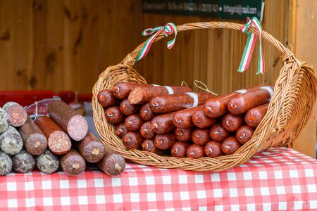 BEKESCSABA, HUNGARY - OKT 19, 2018: Sausage Festival (Csabai Kolbaszfesztival) Sausage exhibition and fair. Smoked thick sausages in a basket