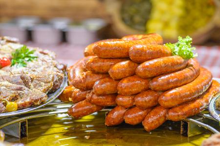 Traditional Hungarian pig slaughter dishes, fried sausages Reklamní fotografie