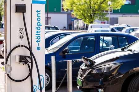 BEKESCSABA, HUNGARY - APR 15, 2019: Electric car filling station on the street. A car during charging.