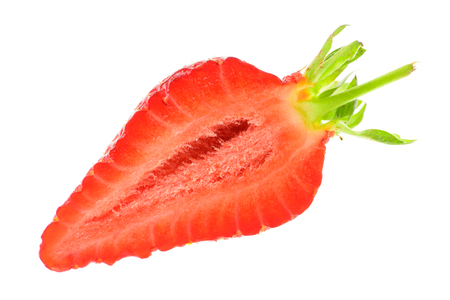 A half cut ripe red strawberry with a green stem. Isolated background.