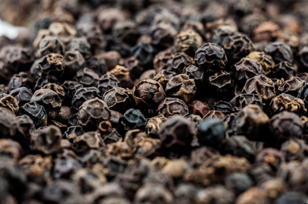 black peppercorn: close up dried black peppercorn Stock Photo