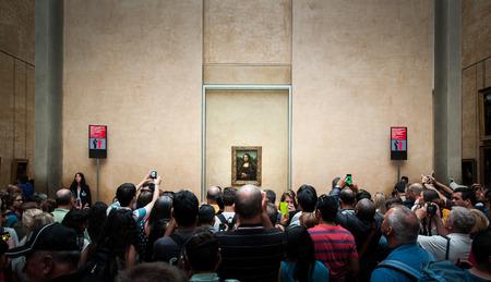 leonardo davinci: PARIS, FRANCE - JUNE 18 , 2014 : A huged of visitors take photos of Mona Lisa , by Leonardo DaVinci