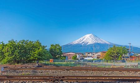 railroad tracks: kawaguchiko railroad tracks with Mount Fuji  in summer