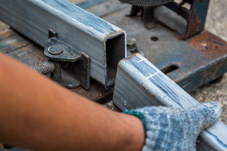 cutted: Close-up of cutted steel sections with compound mitre saw and circular blade
