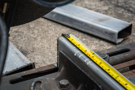 blade cut: measuring a metal that already cut with measuring tape on compound mitre saw with circular blade