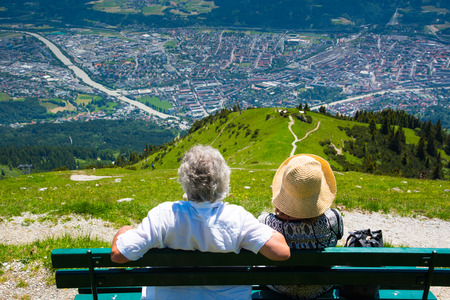 Europe couples relaxing and looking to Innsbruck city from Seegrube mountain in sunny day