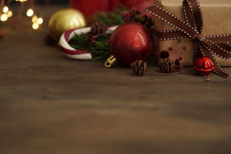 Christmas decorations.Gift box, Christmas candy, fir branches, balls on a wooden background, selective focus.Christmas and New Year concept.Copy spaec.