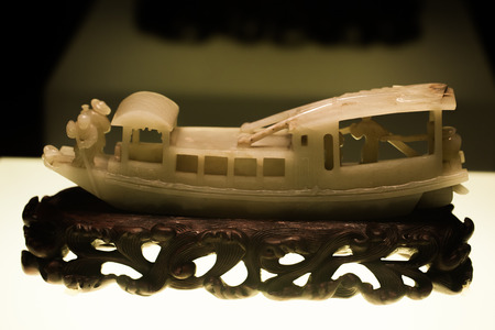 artifact: Ancient artifact jade with a boat shape carving
