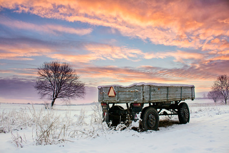 Old trailer in winter Stock Photo