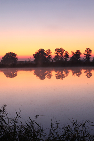 Sunset in pond Stock Photo