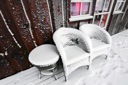 Summer garden furniture covered with snow after snowstorm . The picture taken in Norway. Stok Fotoğraf - 122800805