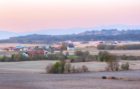 Spring sunset at The agricultural area Byneset near the city Trondheim